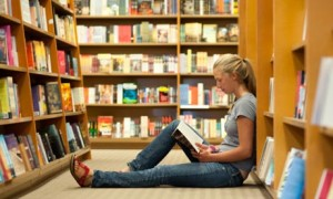 NBT: Girl sitting in bookstore